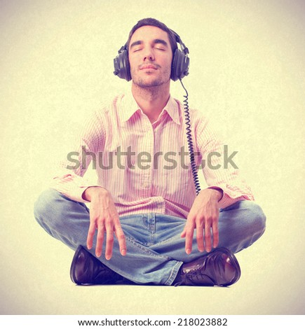 young man listening music by headphones. - stock photo