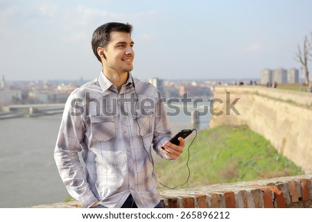 Young man listening music on a smart phone