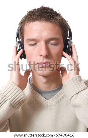 young man listening music with headphone isolated on white background - stock photo