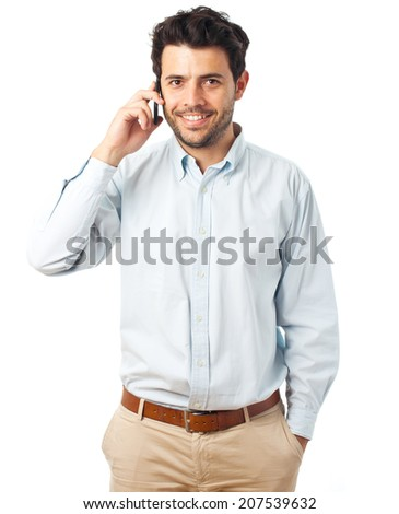 young man listening on a phone on a white background - stock photo