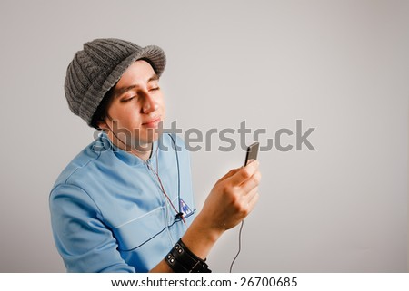 Young man listening to his music player - stock photo