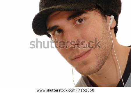 young man listening to mp3 player through white earphones, isolated on white - stock photo