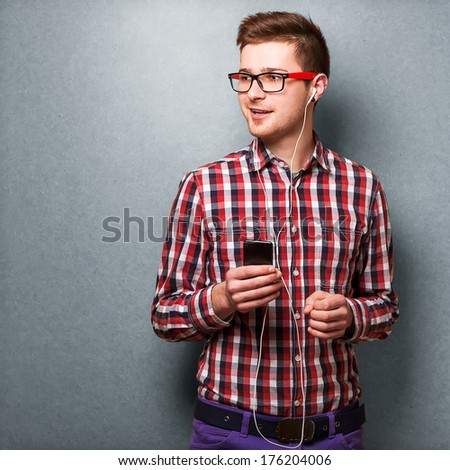 Young man listening to music. Hipster style - stock photo