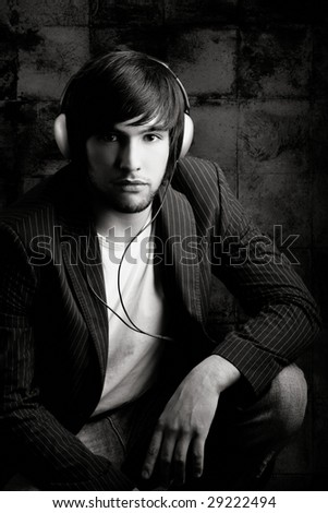 Young Man listening to music with headphones - stock photo