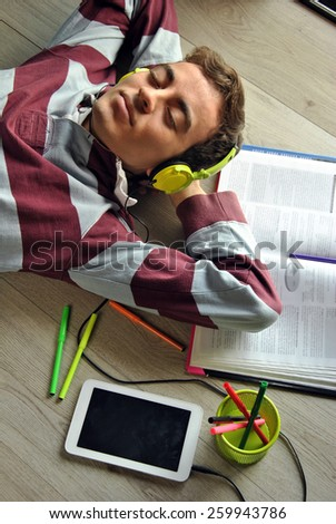 Young man listening to music with mobil - stock photo
