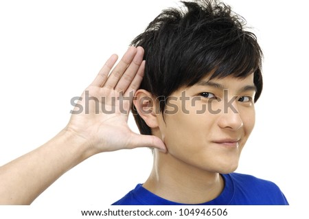 young man listening with hand on ear isolated