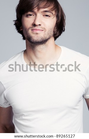 young man long hair in white t-shirt portrait - stock photo
