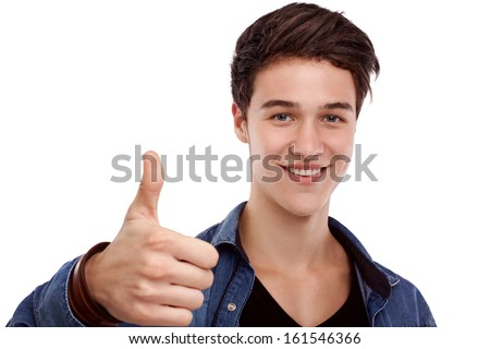 Young man looking ahead and doing ok gesture - stock photo