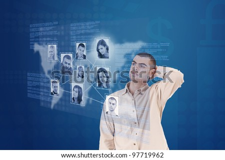 young man looking at social network structure interface display - stock photo
