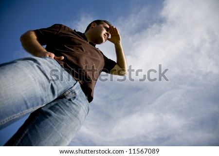young man looking at the horizon - stock photo
