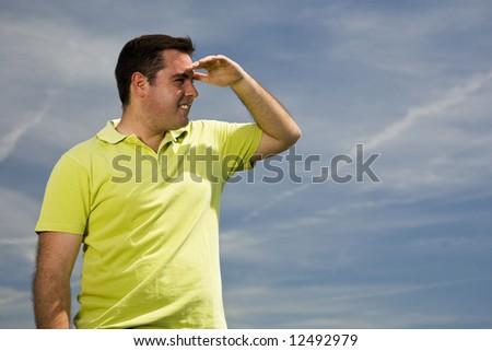 young man looking at the horizon - stock photo