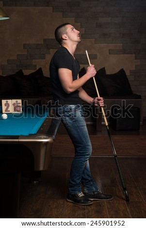 Young Man Looking Confused Lost His Billiard Game - stock photo