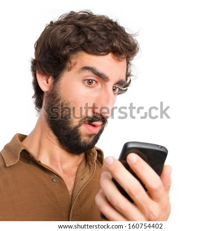 Young man looking skeptical to his smartphone