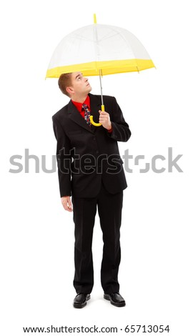 Young man looking up through his transparent umbrella. Raw image of a man protecting himself from imaginary falling objects - stock photo