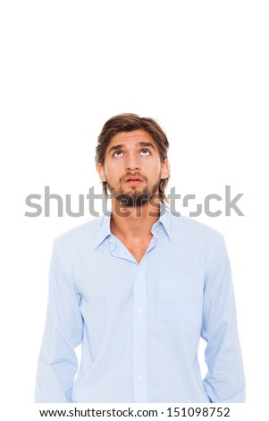 young man looking up to empty copy space, businessman wear blue shirt isolated over white background, Concept of idea, ask question, think up, choose, decide, - stock photo