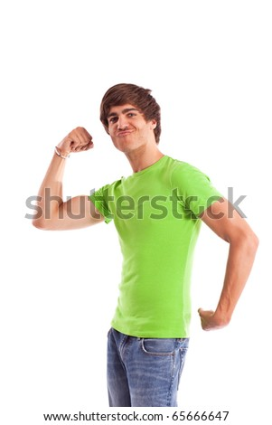 young man makes a funny grimace while showing his biceps