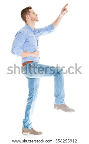 Young man making a step - isolated on white background
