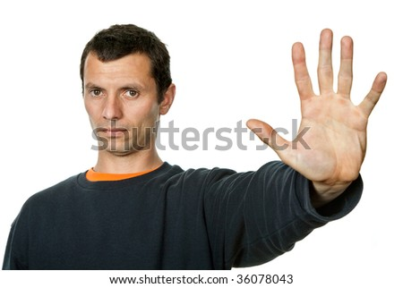 young man making stop with his hand - stock photo