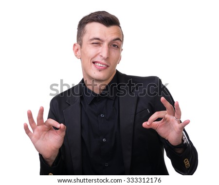 young man making the ok hand sign isolated on white studio shot - stock photo