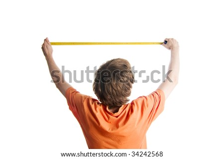 Young man measuring something with a ruler - stock photo