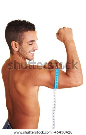 Young man measuring the circumference of his upper arm - stock photo