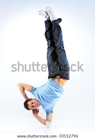 Young man modern dance. Bright white and blue background. - stock photo