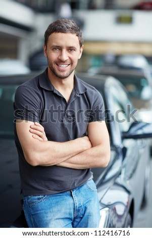 Young man next to the car - stock photo