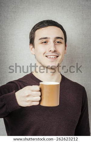 young man offers a cup of tea
