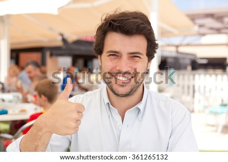 Young man okay gesture - stock photo