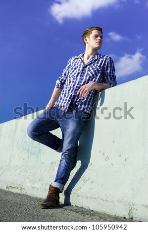YOung man on a road hesitating - stock photo