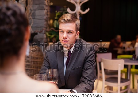 young man on dating with his girlfriend at the restaurant - stock photo
