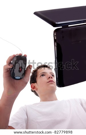 Young man on laptop, view from below, isolated on white, studio shot - stock photo