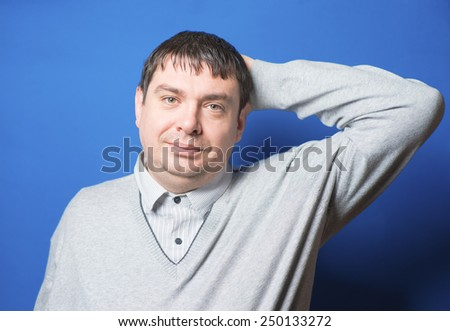 Young man on  relaxing hands behind his head - stock photo