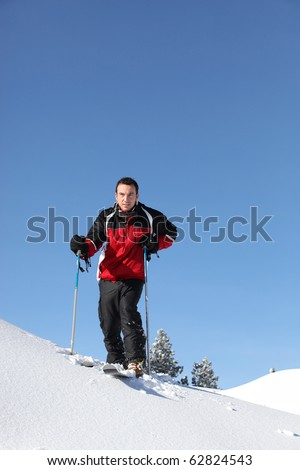 Young man on skis in snow