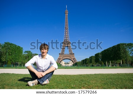 Young man on the Champs de Mars - stock photo