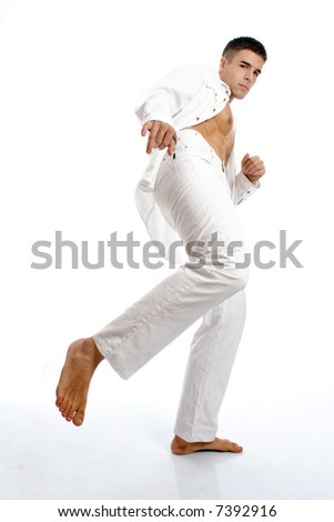 young man on the move with leg, legs are in focus and face motion blur