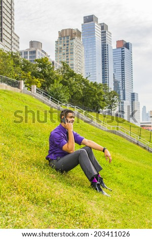 Young Man on the phone. Dressing in a purple shirt, gray pants, a black tie, leather shoes, a young handsome businessman is sitting outside a business district, making a call on a mobile phone. - stock photo