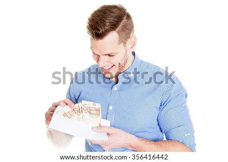Young man opening envelope with money - stock photo