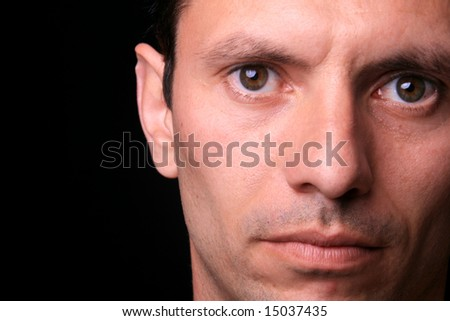 young man over black background - stock photo