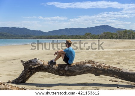 Young man overlooking the sea on summer holiday in Australia. - stock photo
