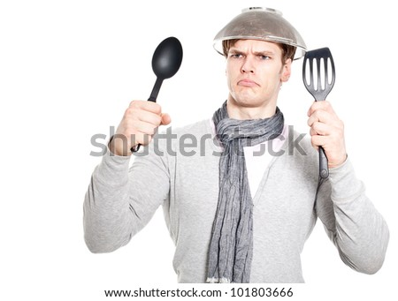 Young man overwhelmed with kitchen work - isolated on white background - stock photo