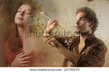 young man paint on a image of a woman - stock photo