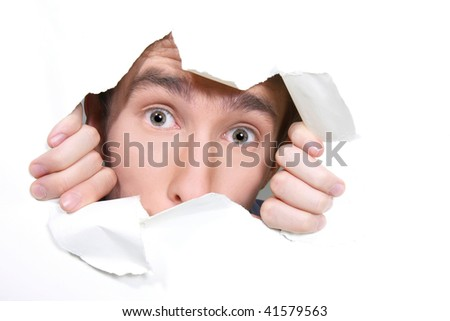 young man peeping through hole on paper