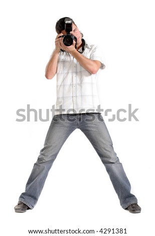 young man photographer holding a photo camera. Isolated over white background
