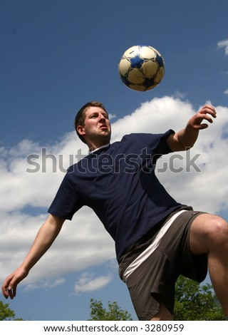 young man play with soccer ball - stock photo