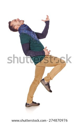 Young man playing air guitar in full length - stock photo