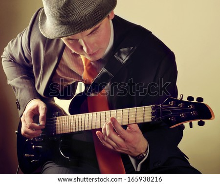 young man playing electrical guitar