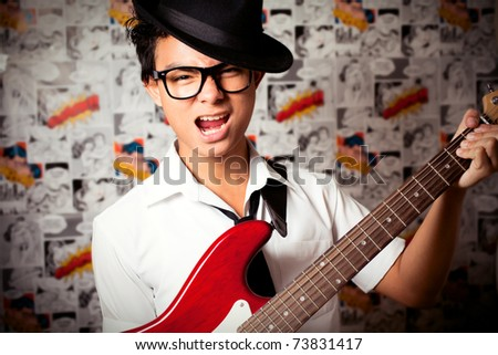 Young Man Playing music - stock photo