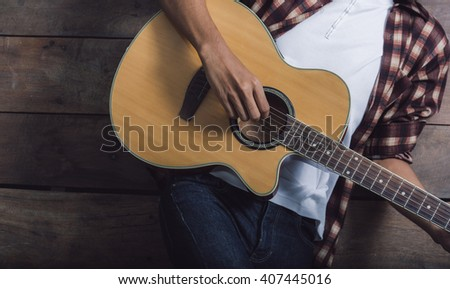 Young man playing the guitar