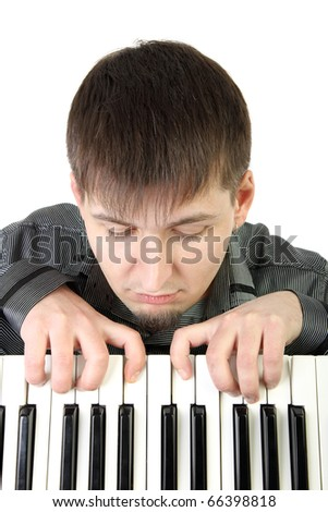 Young man playing the piano isolated background - stock photo
